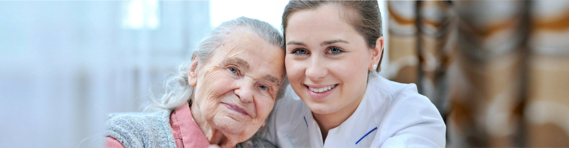 senior woman with caregiver smiling