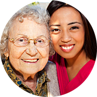 young woman and senior woman smiling
